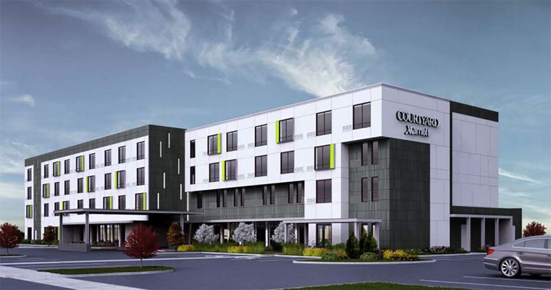 COURTESY RENDERING - Marriott Hotels purchased the land for this four-story hotel from U.S. Bank in 2011.
