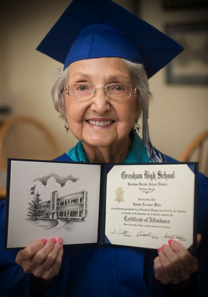 OUTLOOK PHOTO: JOSH KULLA - Nita Parker receives a Gresham High School certificate of attendence as a 90-year-old.