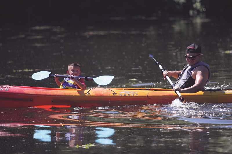 PHIL HAWKINS - Campers were invited to take part in a variety of activities at the Governor's Campout, including kayaking at Willamette Mission State Park's Mission Lake.