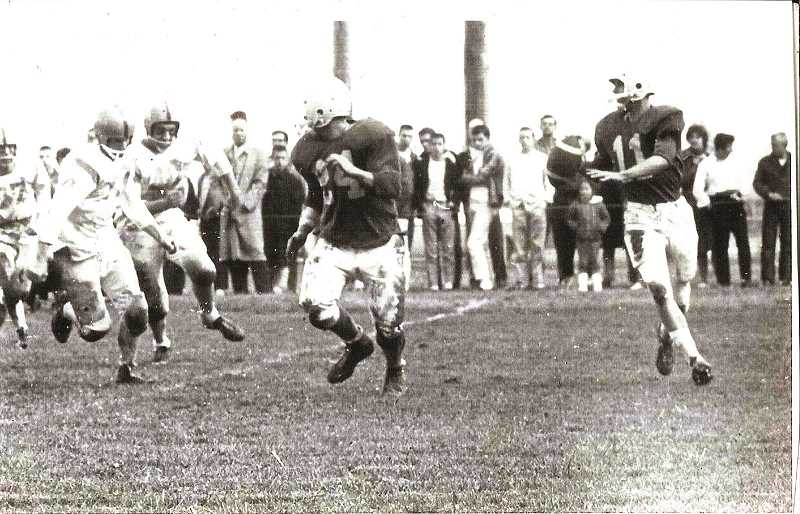 COURTESY OF JOHN THOMAS - Woodburn quarterback Tom Zyp (right) gave the Bulldogs a strong passing game in an era where ground-based offenses were the norm.