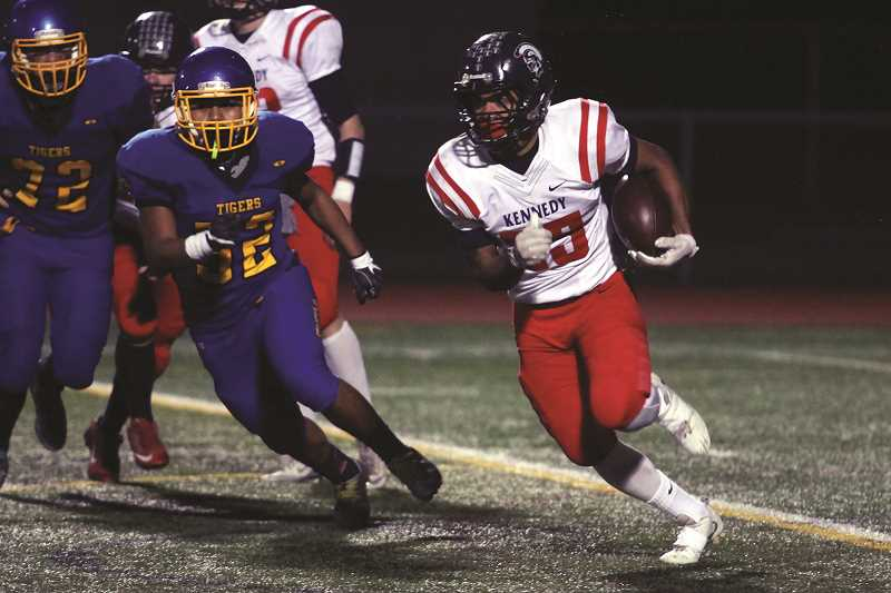PHIL HAWKINS FILE PHOTO - Kennedy's Bishop Mitchell carried the ball one time for four yards for the South team's 10-7 victory over the North in the 2017 Les Schwab Bowl.