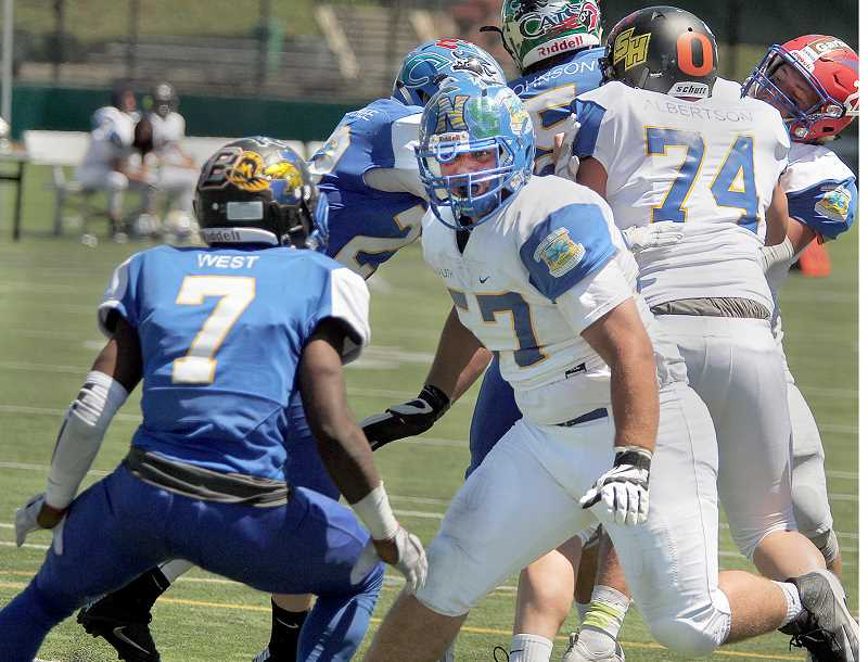 MILES VANCE - PMG - Recent Newberg High School graduate Jacob LaPointe seeks out a block Saturday during the Les Schwab Bowl at Hillsboro Stadium.