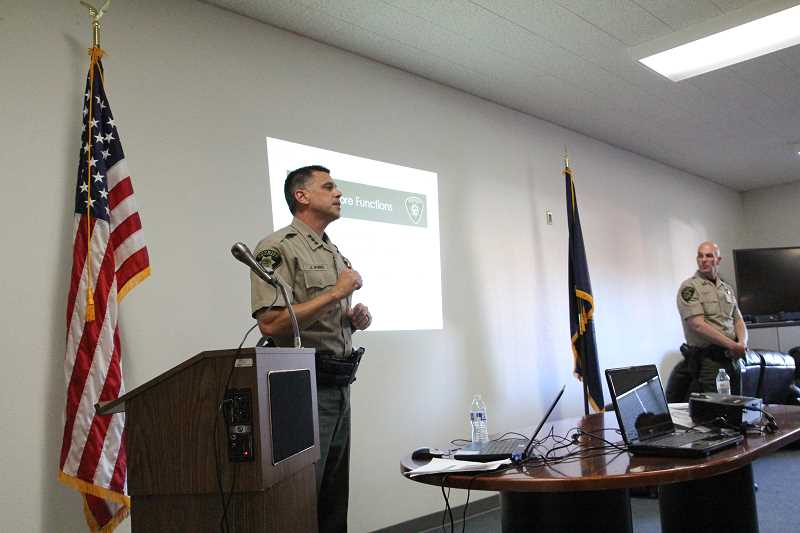 LINDSAY KEEFER - Marion County Sheriff Jason Myers (left) and Commander Eric Hlad give a presentation on services provided by Marion County Sheriff's Office if Hubbard were to contract with the outside agency.