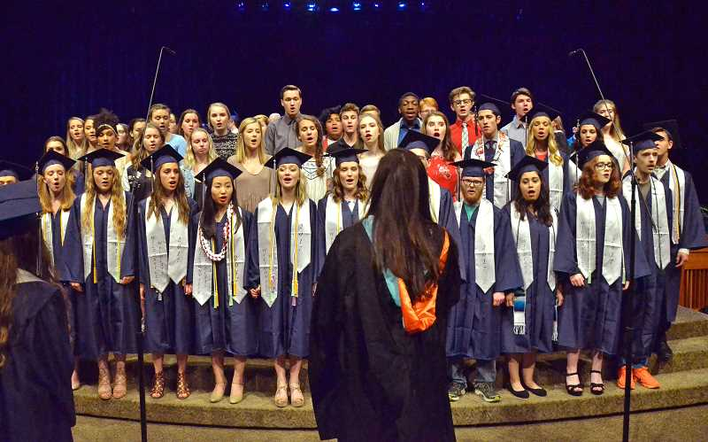SPOKESMAN PHOTO: VERN UYETAKE - The Wilsonville High School Symphonic Choir performs at Wilsonville's 2017 Graduation Thursday, June 15.
