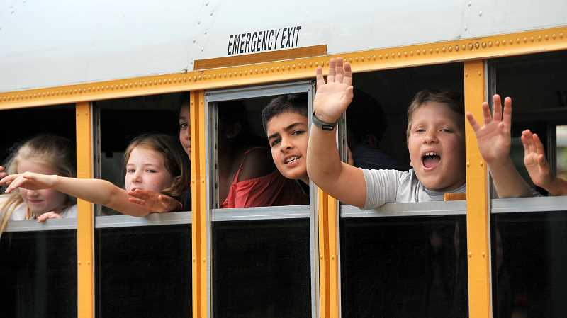 SPOKESMAN PHOTO: VERN UYETAKE - Boeckman Creek Primary students wave goodbye to teachers as they embark on summer vacation.