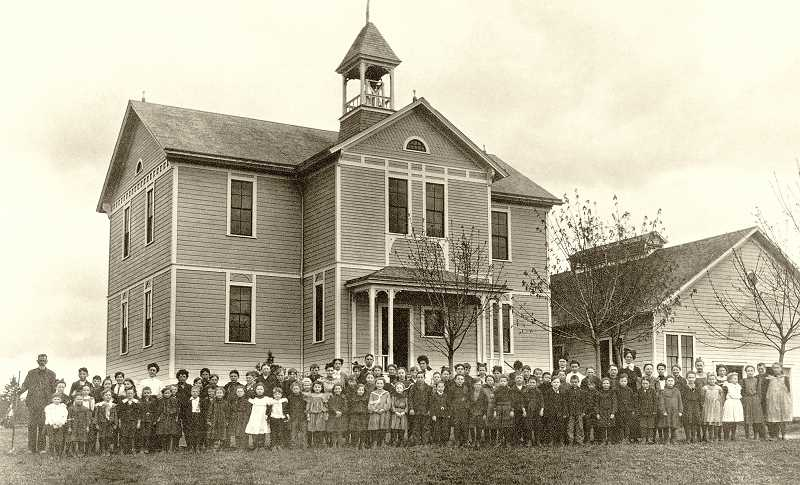 PHOTO COURTESY OF CLACKAMAS COUNTY HISTORICAL SOCIETY - Sunset staff and students stand outside the second iteration of the school, which was constructed in 1917 and burned down in 1941.
