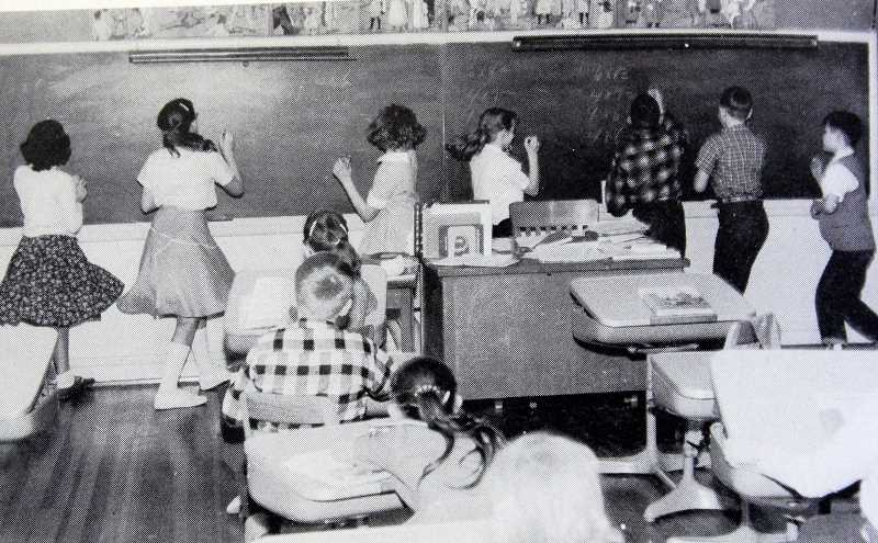 TIDINGS PHOTO: VERN UYETAKE - Sunset students solve math equations on the chalk board some time in the 1950s.
