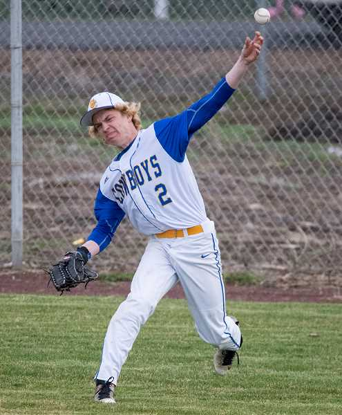LON AUSTIN/CENTRAL OREGONIAN - Keenan Mozingo throws a ball in from right field during one of the Cowboys' games this spring. Mozingo was named honorable mention all-state. He finished the year with a .349 batting average and 16 stolen bases.