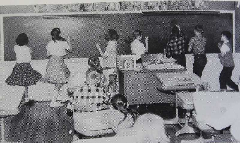 SUBMITTED PHOTO - Sunset students solve math equations on the chalkboard sometime in the early 1960s.