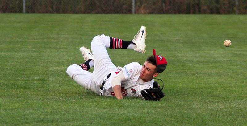 REVIEW PHOTO: MILES VANCE - Perth Colts right fielder Kenji McCarthy tries to make a diving catch during his team's 5-4 loss at Lakeridge on Tuesday evening.