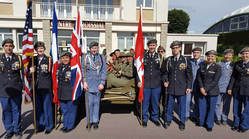 SUBMITTED PHOTO - JROTC cadets Kira Povis, third from left, Amaya Bisland, third from right, and Rabeka Ellis, on far right, get ready to participate in the D-Day Memorial Parade in St. Mere Eglise, France.