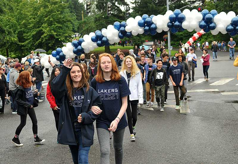 REVIEW PHOTO: VERN UYETAKE - Members of the Class of 2021 take the annual balloon-crossing stroll.