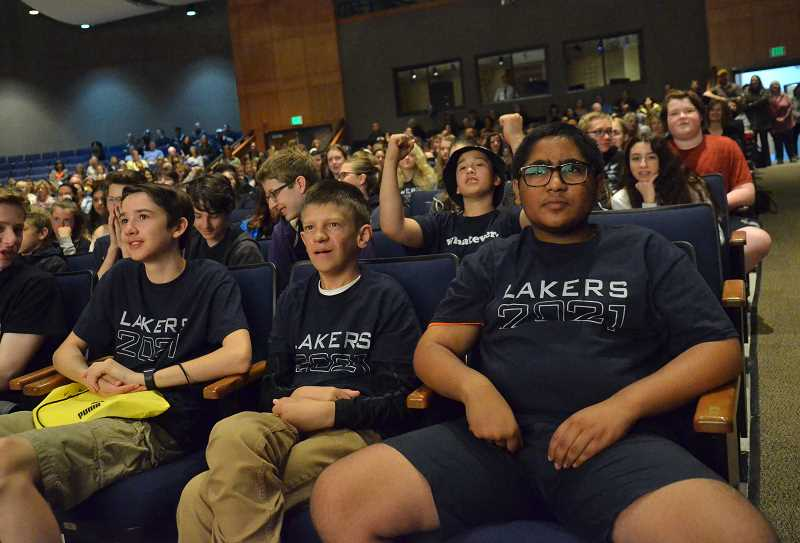REVIEW PHOTO: VERN UYETAKE - Brand-new Lakers listen to a presentation about their future school. From left: Clark Jones, Will Johnson and Kush Patel.