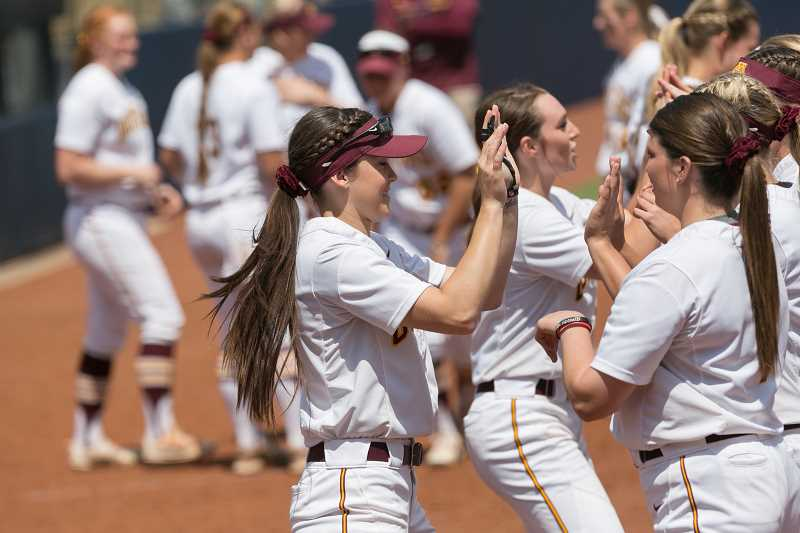 UNIVERSITY OF MINNESOTA ATHLETICS PHOTO - Banks standout alum and University of Minnesota sophomore-to-be celebrates with her teammates during a game last season.