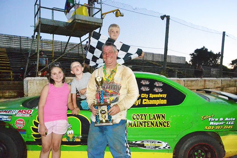 PHOTO CREDIT: L.A.B. PHOTOGRAPHY - Bob Berg, 53, of St. Helens, accepts his Four-Cylinder Division team's third main event win in a row as young fans admire him on Saturday, June 24, at the Columbia County Speedway.