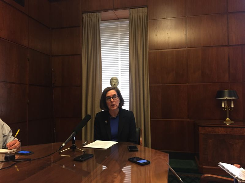 PARIS ACHEN/CAPITAL BUREAU  - Gov. Kate Brown speaks to reporters in her ceremonial office at the Oregon Capitol in Salem Wednesday, June 28, 2017.
