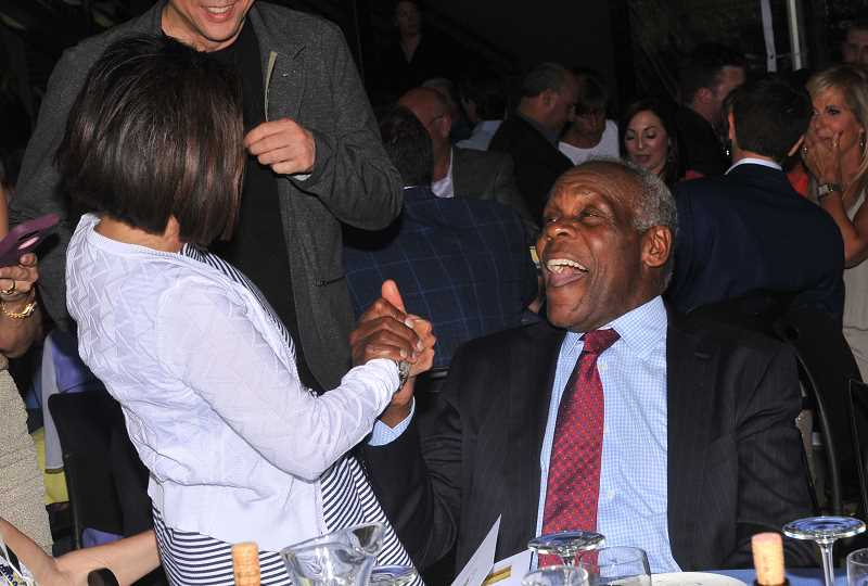 REVIEW PHOTO: VERN UYETAKE - Danny Glover has a good laugh with Deneen King before the actor spoke at An Evening with Danny Glover, a fundraiser for Park Academy held last week.
