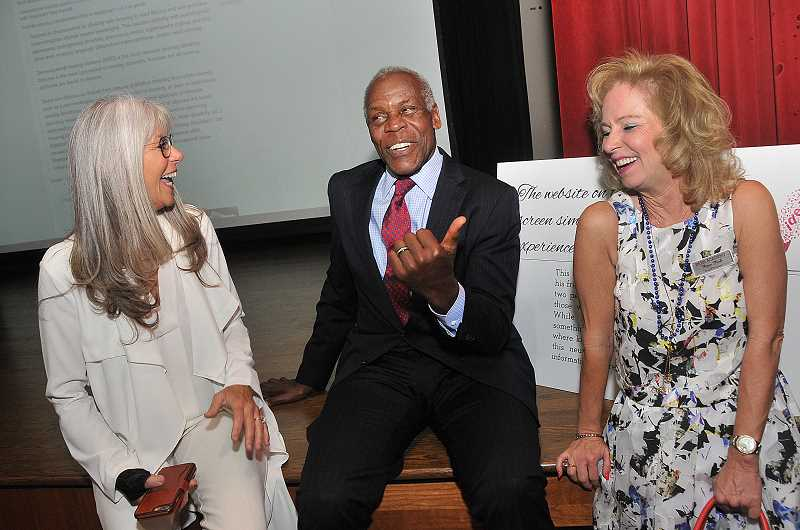 REVIEW PHOTO: VERN UYETAKE - Lisa Martinsson, left, and Piper Park chat with Danny Glover at a fundraiser at Park Academy last week.