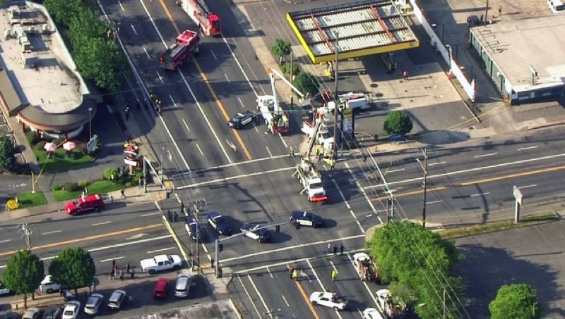 KOIN-6 NEWS - An aeriel view of the intersection of Southeast Stark Street and 122nd Avenue, where witnesses said a man climbed a utility pole, started throwing things down and pulling at wires, and police said was likely electrocuted.