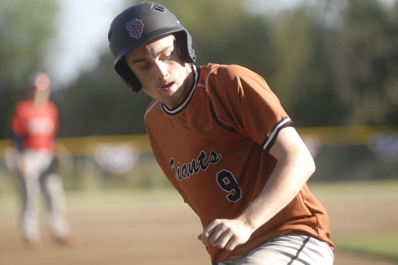 SANDY POST: MATT RAWLINGS - Maysen Graham pops up after sliding safely into third base for Sandy.