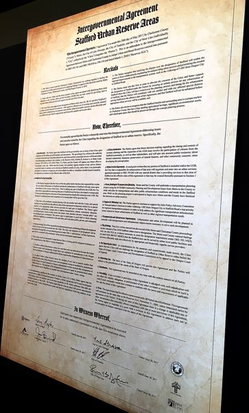 PAMPLIN MEDIA GROUP: PETER WONG - A poster-sized copy of the Stafford agreement.
