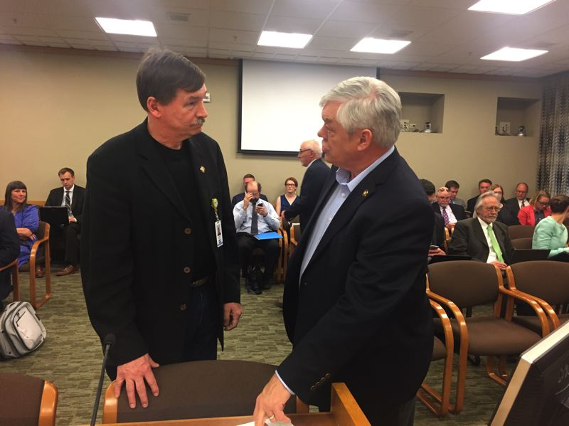 PARIS ACHEN/CAPITAL BUREAU - Sens. Brian Boquist, R-Dallas, and Lee Beyer, D-Springfield, discuss a statewide transportation funding bill at the Oregon Capitol in Salem. (File photo)