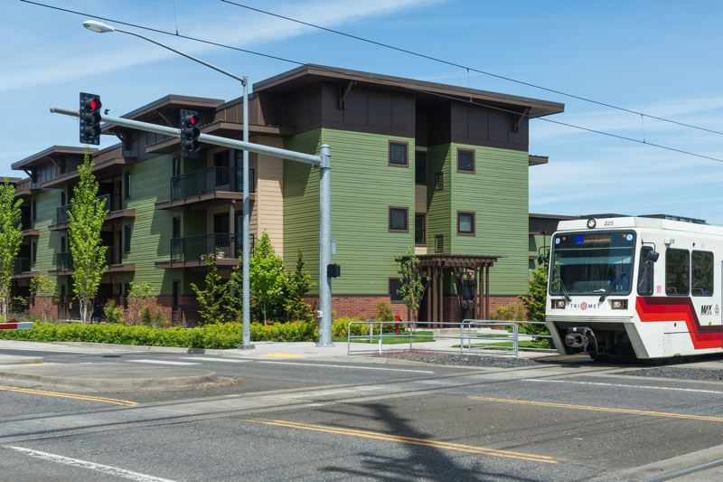 PAMPLIN MEDIA GROUP: CHRIS OERTELL - A MAX train passes in front of the Orchards at Orenco affordable-housing development. Washington County generally looks to place affordable developments near public transit, but the apartments fill up quickly.