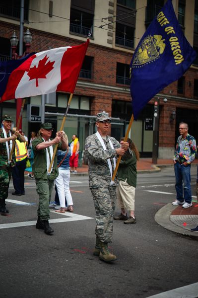 COURTESY  NATHANIEL BOEHME - Nathaniel Boehme is shown holding the Oregon state flag in the Portland Pride Parade color guard on June 18.