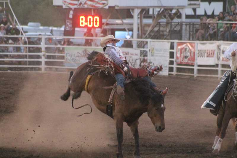 PIONEER PHOTO: CONNER WILLIAMS - Mason Clements took the lead in the bareback riding Sunday night with an 85-point performance aboard Flying 5 Rodeo's Spring Tunes.