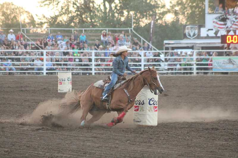 PIONEER PHOTO: CONNER WILLIAMS - Molalla's Rachel Stoller sits in third place in the barrels after a 17.62-second performance Sunday night.