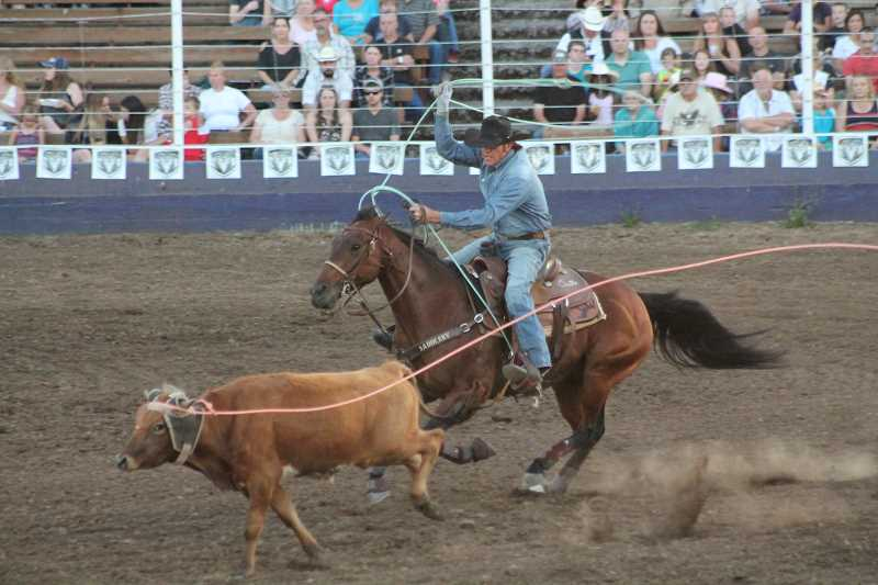 PIONEER PHOTO: CONNER WILLIAMS - Clay Tryan, along with partner Jade Corkill, sit just behind Erich Rogers and Cory Petska in the team roping as they clocked a five flat Sunday night, a tenth of a second off the lead.