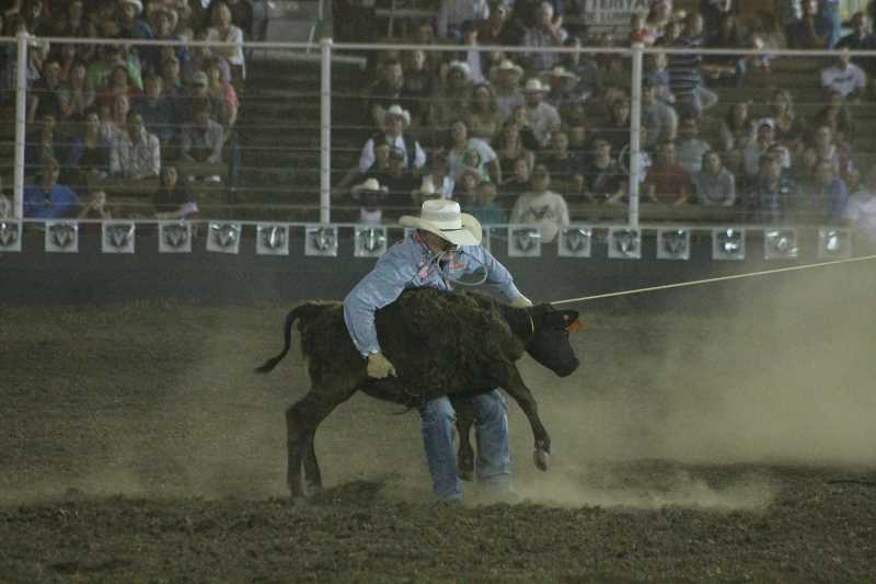 PIONEER PHOTO: CONNER WILLIAMS - Tuf Cooper sits just behind Cade Swor in the tie-down roping as he clocked an eight flat Sunday night to take second place.