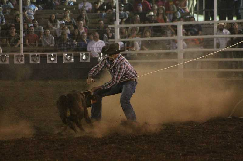 PIONEER PHOTO: CONNER WILLIAMS - Cade Swor took the lead in the tie-down roping Sunday night as he clocked a scorching 7.9.