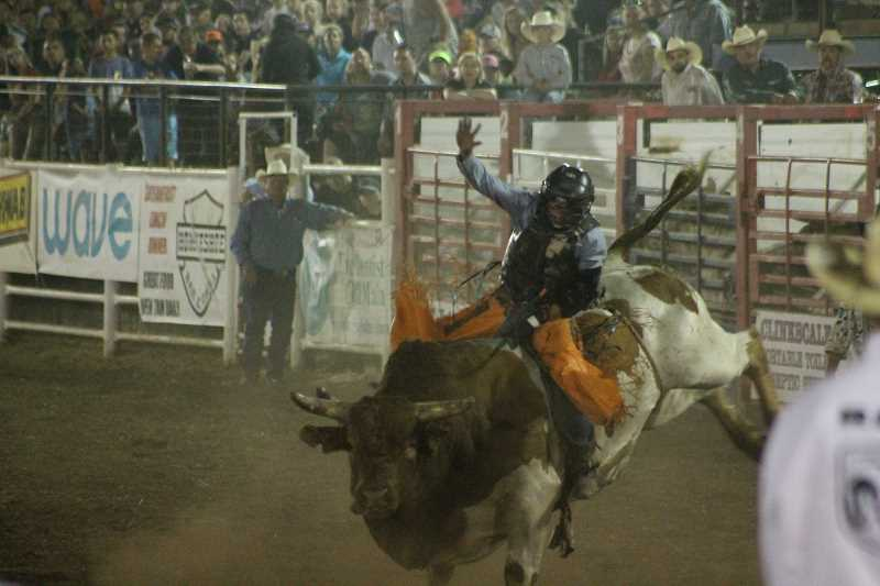 PIONEER PHOTO: CONNER WILLIAMS - Cody Hudson was the only bull rider Sunday night to stay on his bull for the full eight seconds. It's a good thing he did, too, because his 80-point ride put him in second place behind Jordan Hansen.