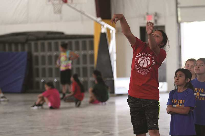 PHIL HAWKINS - Members of the Gervais high school girls basketball program were once participants in the Cougar Hoop Camp, but are now helping to run the camp for the next generation of athletes.