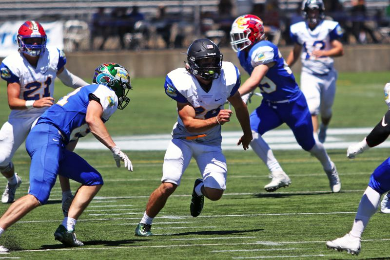 DAN BROOD - Ryan Minniti, a 2017 Tigard grad, looks to get into the action on defense during the South's 10-7 win in the Les Schwab Bowl.