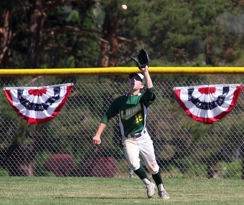 TIDINGS PHOTO: MILES VANCE - West Linn center fielder Griffin Banta prepares to make a catch during his team's 6-1 win over Aloha in the Firecracker Classic tournament at Lakeridge High School on Saturday.