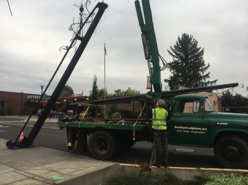 COURTESY PHOTO BY PHIL THORNBURG - One of the set of banner poles on Main Street in Tigard is put up on June 27.