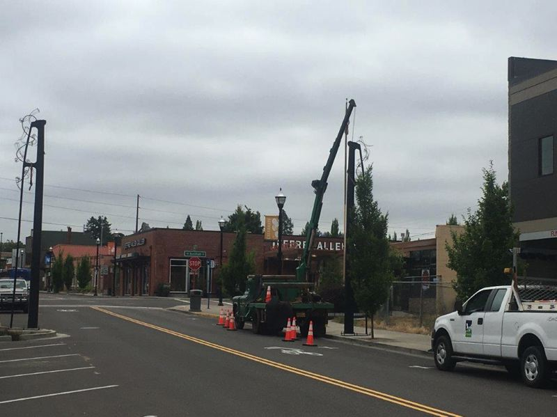 COURTESY PHOTO BY PHIL THORNBURG - The new poles on either side of Main Street in Tigard will be rigged to suspend a banner that will promote events going on in the city.