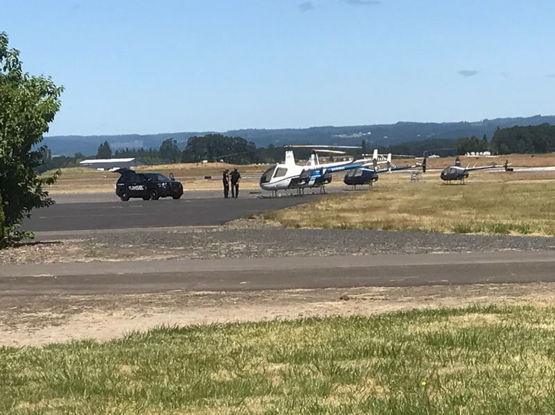 HILLSBORO TRIBUNE PHOTO: GEOFF PURSINGER - Hillsboro Police arrived late Monday morning at Hillsboro Airport after reports of shots fired. A suspect is dead, according to authorities.