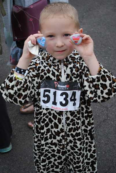 NEWS-TIMES PHOTO: EMILY GOODYKOONTZ - Jacob Green ran in the kids fun run and shows off the love rocks he was given after the race.