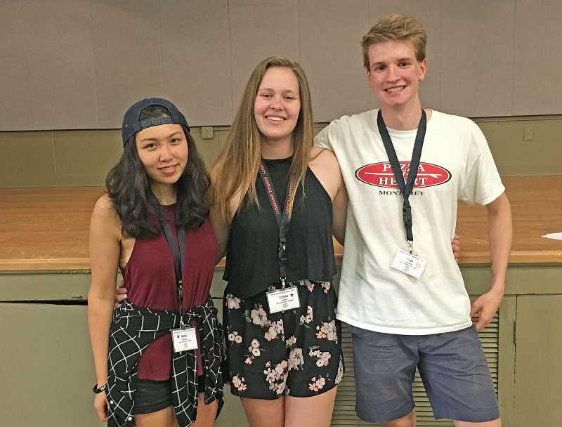SUBMITTED PHOTO - This year's attendees to the World Affairs Seminar were: Lake Oswego High School's Kate Fayloga (left) and Chloe Leeper and Lakeridge High's Joel Saarinen.