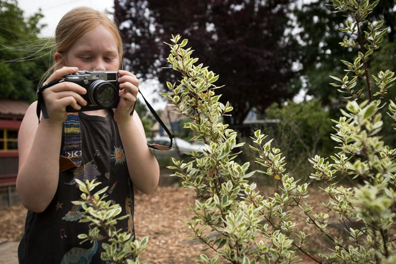 PORTLAND TRIBUNE: JAIME VALDEZ - Francis Rudy, 9, takes photos at Vibe. Her mom, Posy Quarterman, is the photography camp coordinator.