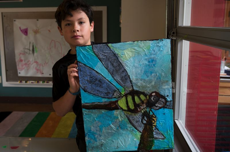 PORTLAND TRIBUNE: JAIME VALDEZ - Sam Ng, 10, holds up a dragonfly he made from tissue paper and acrylic paint. He's been going to Vibe for five years.