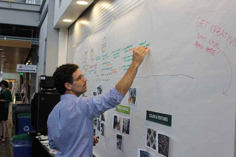 SPOKESMAN PHOTO: ANDREW KILSTROM - An MIG consultant takes visual notes during Monday's open house June 26.