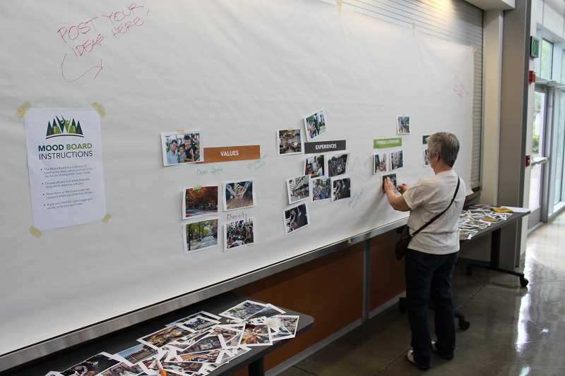 SPOKESMAN PHOTO: ANDREW KILSTROM - Citizens had the opportunity to pick out specific examples that appealed to them during Monday's open house June 26 at Clackamas Community College.