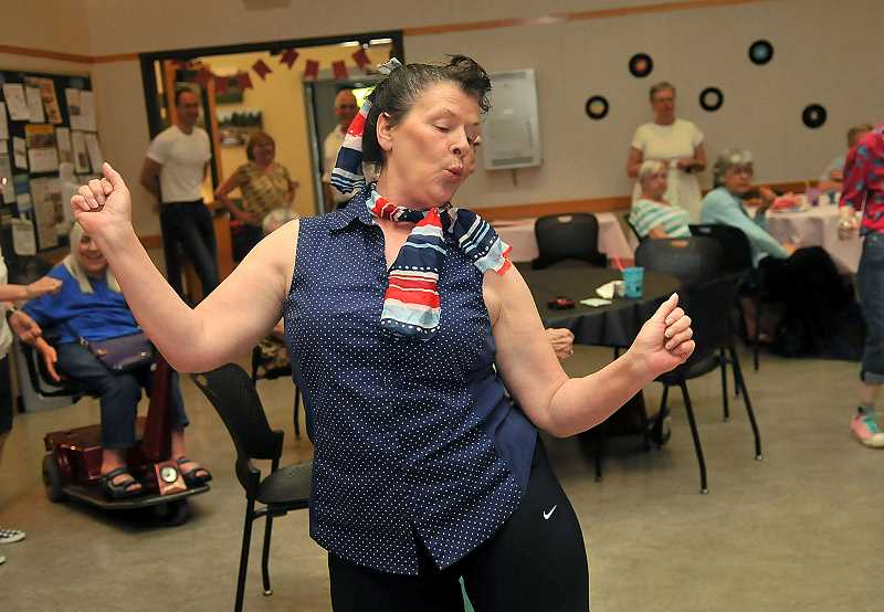 SPOKESMAN PHOTOS: VERN UYETAKE - Sherie Rogers twisted the afternoon away at the  Wilsonville Community Centers senior dance June 29.
