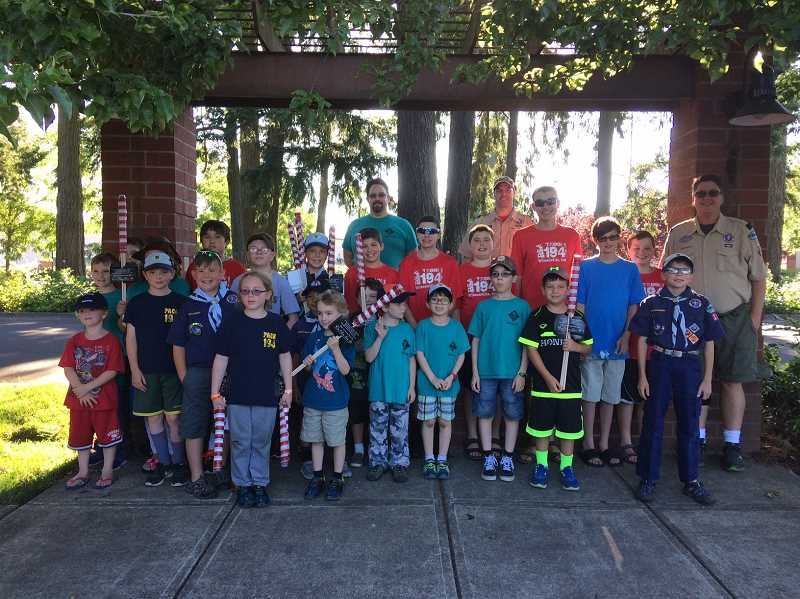 SUBMITTED PHOTOS - Pack 194, pack 199 and Troop 194 get ready to pass out flags Thursday, June 29.