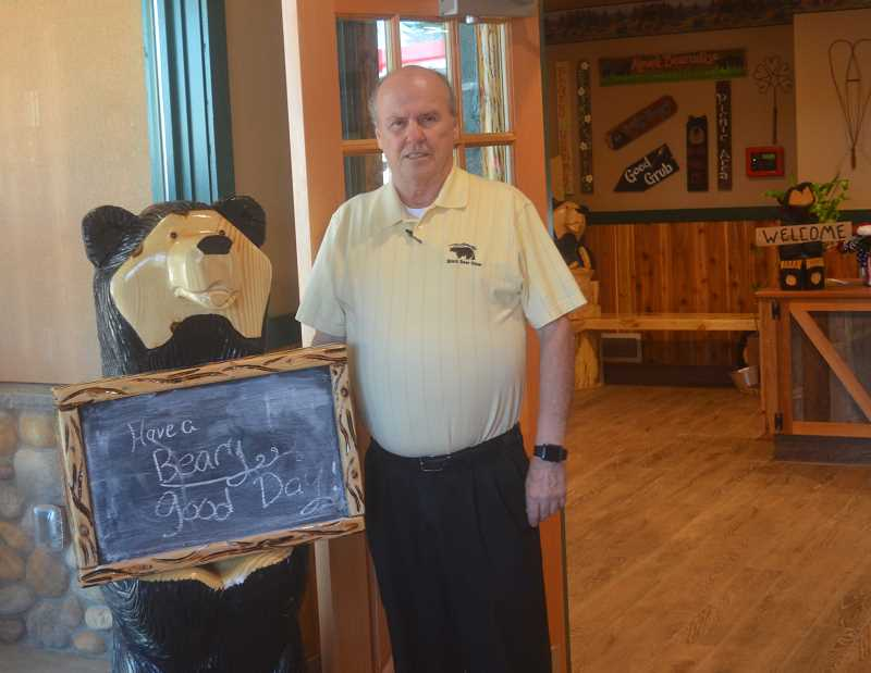 SPOKESMAN PHOTO: COREY BUCHANAN - Black Bear Diner General Manger Tim Bowen poses for a photo with a bear sculpture at the new Black Bear Diner in Wilsonville.