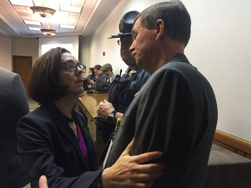 PARIS ACHEN/CAPITAL BUREAU - Gov. Kate Brown speaks to Sen. Brian Boquist, R-Dallas, before a hearing on a suicide-prevention bill at the Oregon Capitol in Salem April 17, 2017.